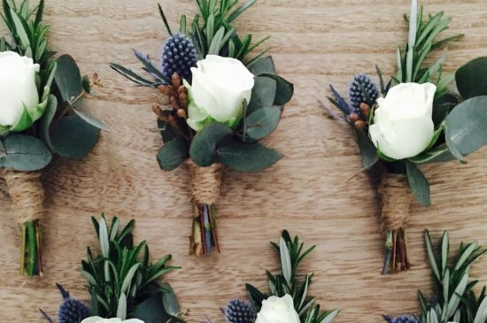 Rose and sea holly men's corsages
