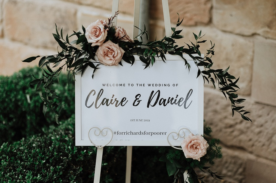 wedding ceremony sign floral arrangement