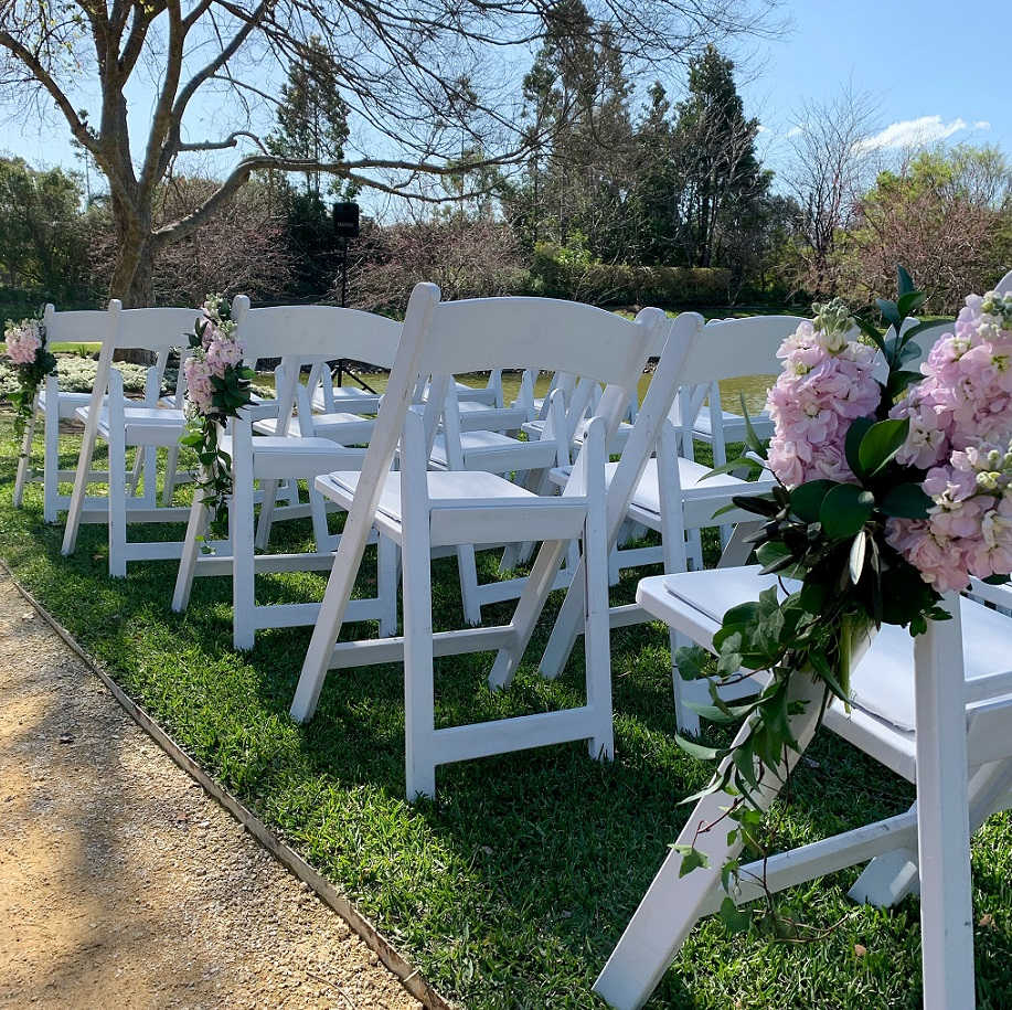 wedding ceremony chair flowers