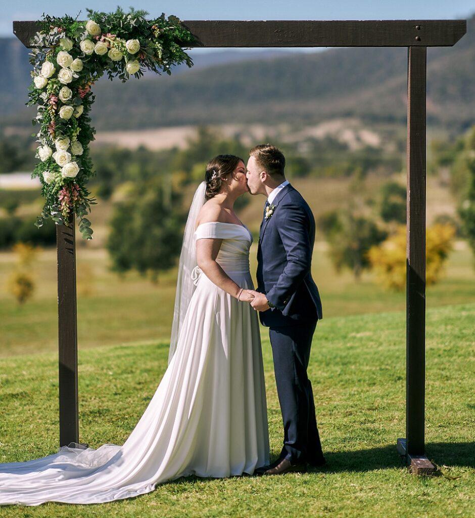 wedding ceremony arch flowers